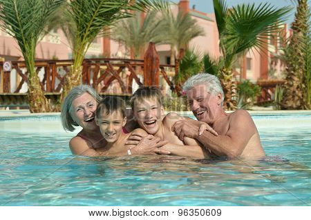 Grandparents with  grandchildren in pool