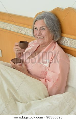 Mature woman with coffee