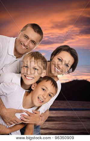Cheerful family in the sunset together
