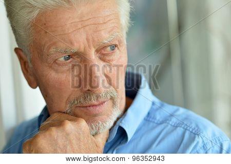 Sad senior man at home