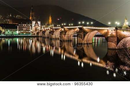 Heidelbergs Old City At Night Reflecting In The Neckar