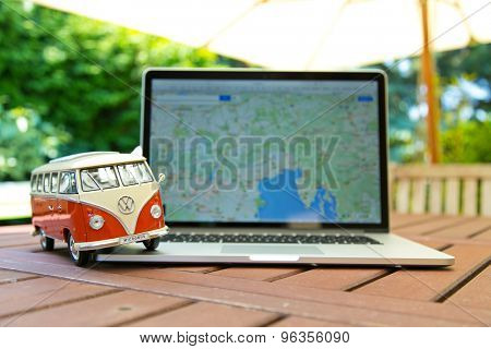 PRAGUE, CZECH REPUBLIC - JULY 10, 2015: Miniature VW Bulli 1962 on laptop. The cult car of the Hippie generation and it remained the status vehicle of the high wave surfers.