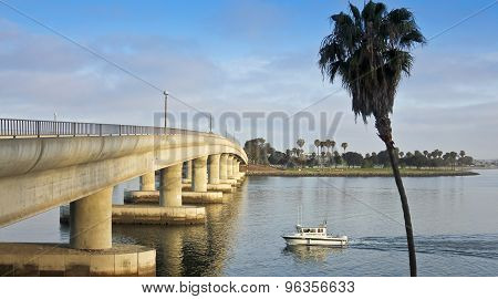 A Fishing Boat Approaches A Mission Bay Bridge