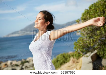 beautiful happy lady stretching out and embracing the sunlight