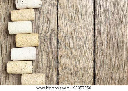 Wine corks over wooden surface with copyspace on the right