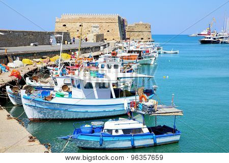 Venetian Fortress and fishing boats in Heraklion, Crete, Greece