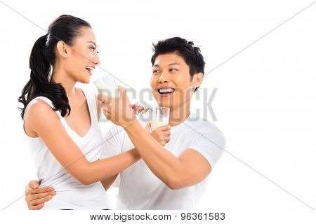 Asian Chinese couple drinking milk living healthy