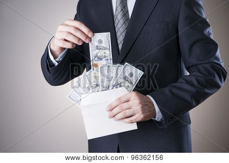 Businessman With Money In Studio