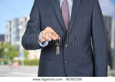 Cropped Image Of Estate Agent Giving House Keys Outside