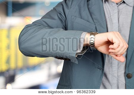 Businessman Checking Time On His Watch At The Airport.