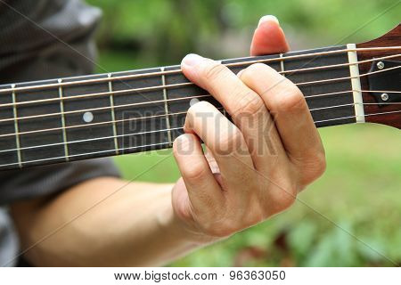 playing guitar chord G
