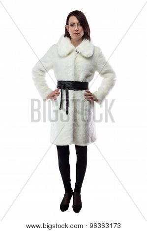 Image of woman in white fur coat, full length