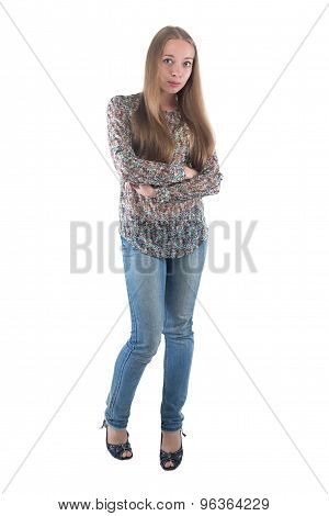 Young woman in jeans with arms crossed