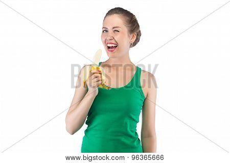 Photo of happy blinking woman with banana