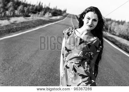 Black And White Photo Of A Sexy Woman Staying On The Road
