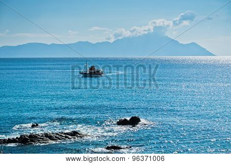 Ship is avoiding dangerous rocks near Sarti in Sithonia