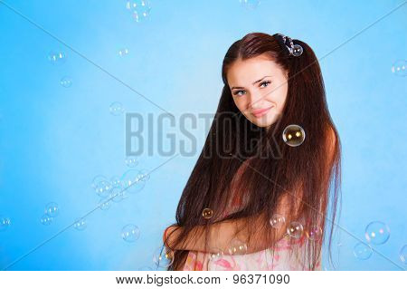 Pretty Young Woman With Soap Bubbles