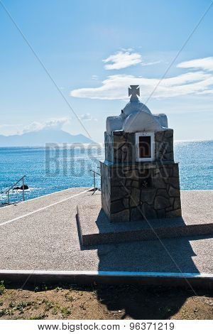 Small stone church or chapel, holy mountain Athos in background