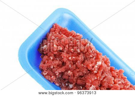 fresh raw mince beef meat on blue tray isolated over white background
