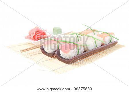 Japanese traditional cuisine - Set of Tuna (maguro) Salmon (sake) and Eel (unagi) Nigiri Sushi  with Wasabi  and Ginger on bamboo mat isolated over white background