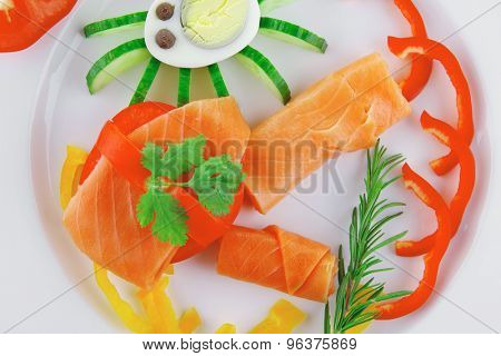 diet healthy food - fresh smoked sea salmon rolls with tomatoes egg and rosemary on plate isolated over white background