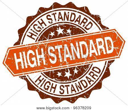 High Standard Orange Round Grunge Stamp On White