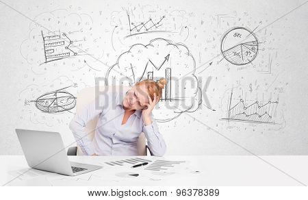 Business woman sitting at white table with hand drawn graph charts