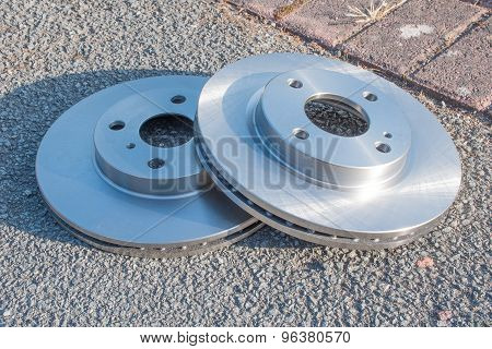 Pair Of New Car Brake Disks Ready To Be Fitted