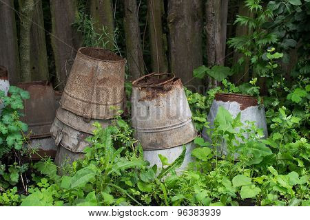 Many Old Buckets Collected By The Fence