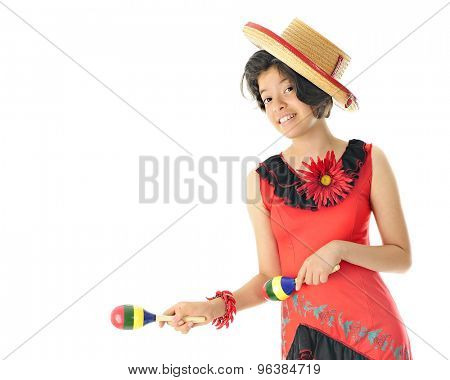 A young teen girl dancing in her red and black Mexican dress and hat, happily accompanying the beat with colorful maracas.  On a white background with space on the left for your text.