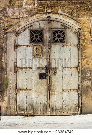 wooden garage doors in a street of Valletta historical center in Malta