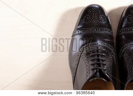 Footwear Concept. Pair Of Black Fashionable Male Oxfords Semi-brouge Laced Shoes