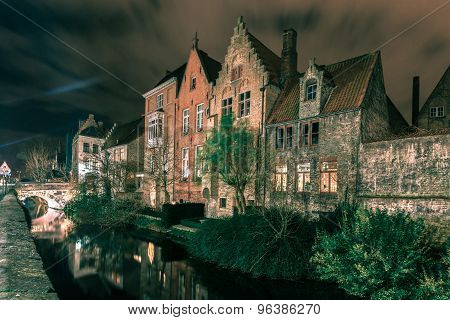 Picturesque night canal in Bruges, Belgium
