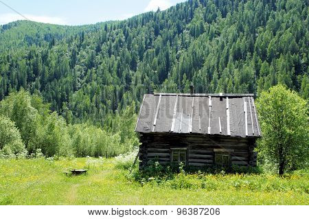 Old abandoned house in the Siberian village. Sayan. Siberia. Khakassia.