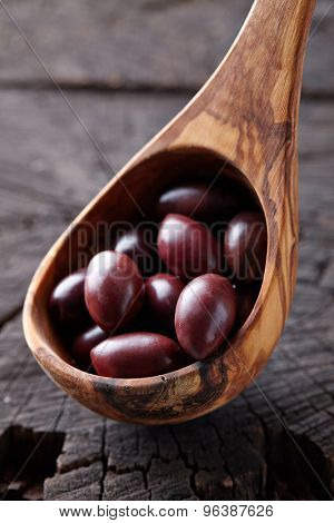 Olives in a wooden background