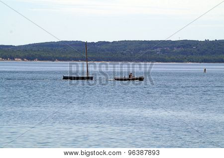 Towing a Rowboat Across the Bay