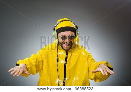 Man wearing yellow suit listening to headphones