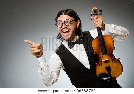 Man playing violin in musical concept