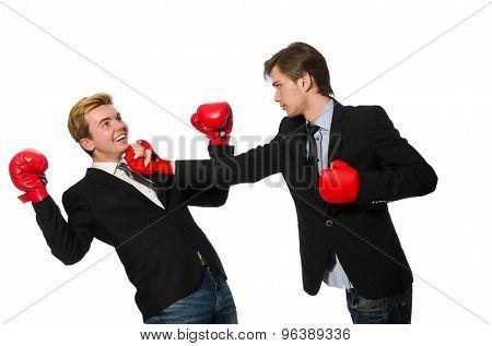Pair of businessmen boxing on white