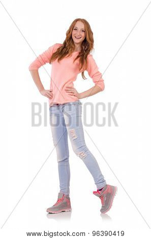 Cute smiling girl in pink blouse and jeans isolated on white