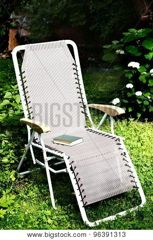 chaise longue body chair in the summer garden