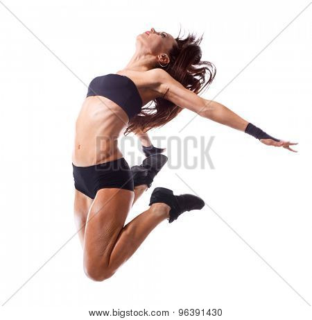Stylish and young modern style dancer jumping .