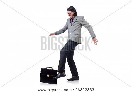 Young businessman in gray suit holding briefcase isolated on white