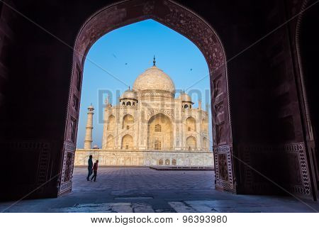AGRA, INDIA - 28 FEBRUARY 2015: View of Taj Mahal from inside Mihman Khana with people passing by. East side of Taj.