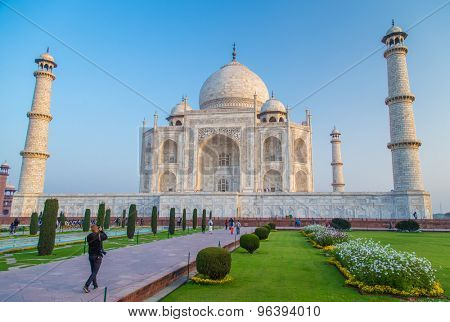 AGRA, INDIA - 28 FEBRUARY 2015: View of Taj Mahal towards South side. Visitor with camera.