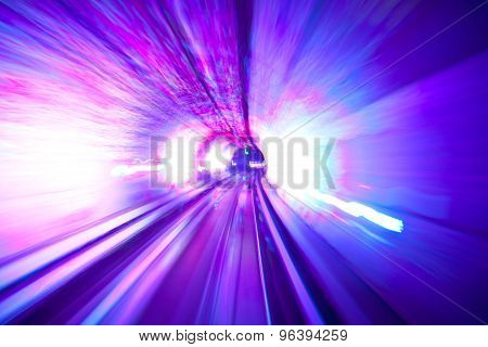 Motion blurred image of travelling through a tunnel
