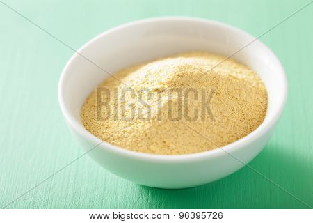 vegan nutritional yeast flakes in bowl