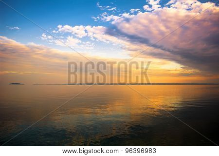 Clouds over sea at sunset