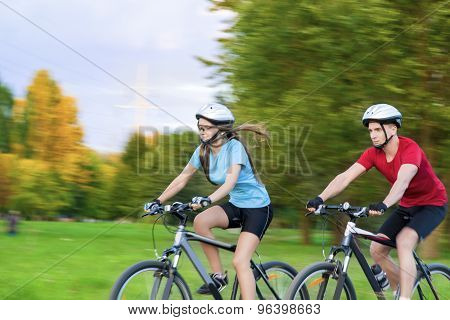Caucasian Couple Having Bicycle Trip Outdoors Together