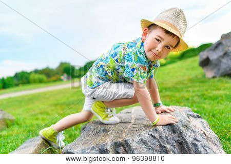 boy cragsman of five years, training to ascend without insurance